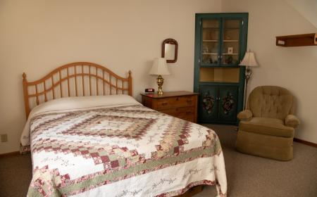 Queen bed and chair