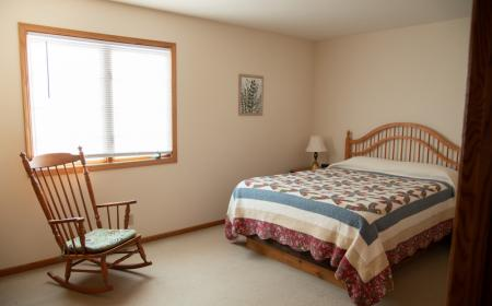 Queen bed with rocking chair